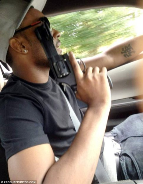 Nick-Gordon-is-seen-holding-the-firearm-up-to-his-face-while-driving-a-car-using-the-other-hand.jpg